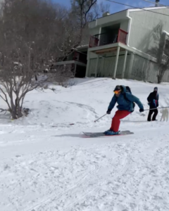 A skier skis down the street in Austin
